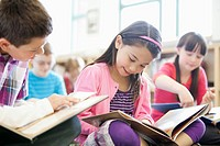 Elementary students reading in class (thumbnail)