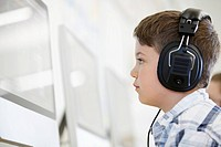 Elementary student with headphones in computer lab