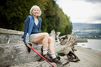 Attractive senior woman resting from hike