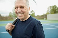 Senior man with tennis racquet