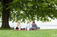 Women relaxing on blanket in the park
