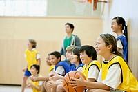 Teacher with basketball teams.