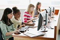Middle school students learning in computer lab