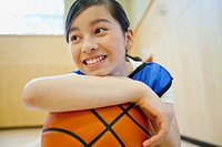 Middle school student with basketball