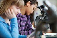 Middle school students using microscopes (thumbnail)