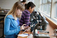 Middle school students using microscopes