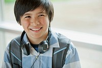 Middle school student with headphones