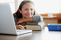 Pretty, middle school student at computer (thumbnail)