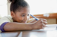 Pretty, young student writing at desk