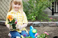 Cute, 5 year old girl planting flowers