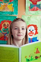 School girl 8_9 posing with book