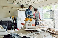Father and son in the garage with renovation materials