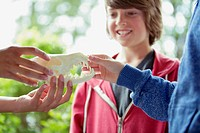 Middle school students touching animal skull