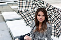 portrait of a beautiful girl with an umbrella