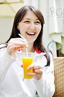 woman drink juice outdoor