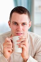 Portrait of a man having a tea