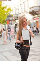 Young Business Woman with tablet computer walking in public spac