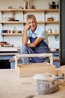 Portrait of man in pottery workshop