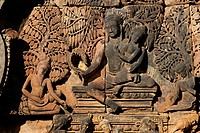 Banteay Srei with bas relief in red sandstone of the Hindu Gods Shiva & Parvati, 10th century Khmer architecture at Angkor Wat _ Siem Reap, Cambodia