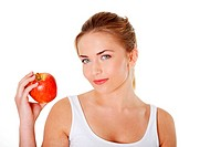 Young beautiful woman eating red apple