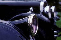 Detail of VINTAGE HEADLAMP at the CONCOURSE D´ELEGANCE _ PEBBLE BEACH, CALIFORNIA