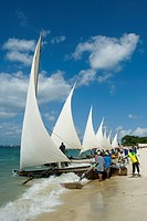 Preparations for a regatta with Ngalawa, traditional double_outrigger canoes, on the beach of Stone Town, Zanzibar, Tanzania, Africa