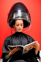 Portrait of a student under a hairdressing machine