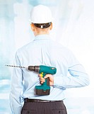 Portrait of successful male worker with cordless drill