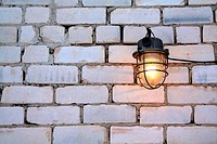aging lamp on brick wall