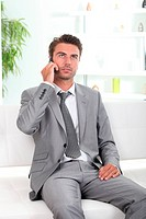 Bored executive on cellphone