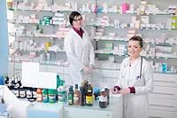 team of pharmacist chemist woman group standing in pharmacy drugstore