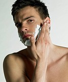 portrait of man with shaving foam