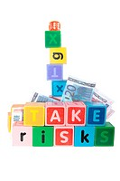 take risks in childs letter play blocks