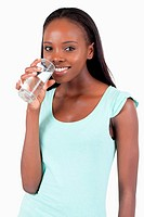 Happy smiling woman having a glass of water
