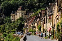 La Roque-Gageac, Dordogne, Aquitaine, France. The main street and the 19th century Château de la Malartrie.