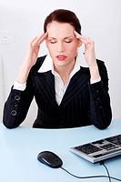 Businesswoman having headache.