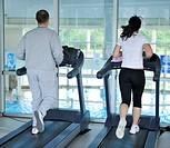 healthy people running on threadmill at sport club representing sport recreation exercise and healthy lifestyle concept