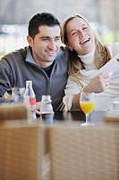 young happy couple have fun on coffee break at bright morning