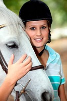 Blond teenage horse rider