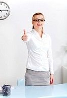 Woman in the office showing okay gesture.