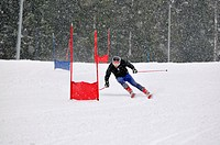 young skier race fast downhil at winter snow scene