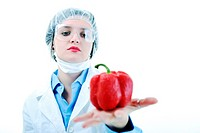 isolated on white young nurse doctor woman with red vegetable food papper representing bio food concept