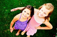 two happy young girls children have fun outdoor in nature