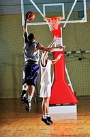 one healthy young man play basketball game in school gym indoor