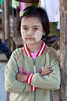 Myanmar, Burma  Mingun, near Mandalay  Young Burmese Girl  She is wearing thanaka paste on her face, a cosmetic sunscreen