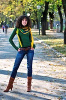 brunette Cute young woman with colorful scarf posing outdoors in nature