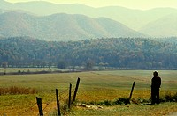 Elderly man enjoying the prairie view at Cades Cove, TN. Cades Cove is the most visited part of the Great Smoky Mountains National Park. Cades Cove wa...