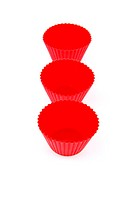 Red plastic cups for small cakes on white