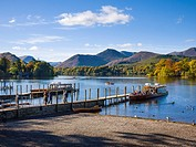 Ferries on Derwent Water at Keswick in the Lake District Park, Cumbria, England, United Kingdom  Causey Pike fell can be seen across the lake