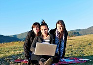 group of teen girl woman outdoor have fun and study homework on laptop computer